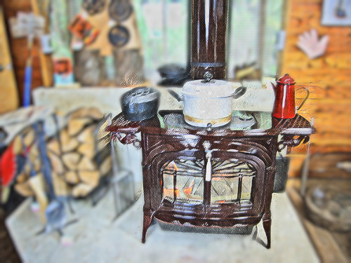 薪ストーブの上で蒸し器で調理